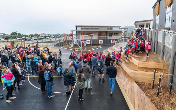 Students and staff enter Te Raekura Redcliffs School as it is reopened nine years after the Canterbury earthquakes.