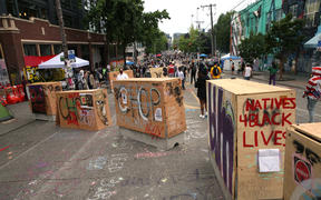 Barricades erected by the city several days ago divide up the CHOP zone in Seattle.