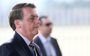 Brazilian President Jair Bolsonaro gestures as he speaks to supporters while leaving Alvorada Palace in Brasilia, on 6 May 2020.