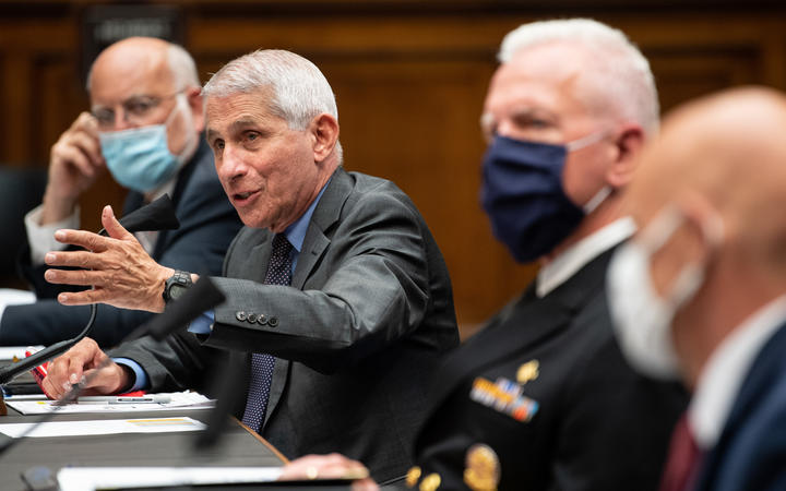 From left to right, Dr Robert Redfield, Dr Anthony Fauci, ADM Brett P. Giroir, and Dr. Stephen M. Hahn testify during a House Energy and Commerce Committee hearing in Washington, DC on June 23, 2020.