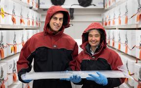 Nancy Bertler and Richard Levy hold an ice core collected from Antarctica which holds a record of past climate.
