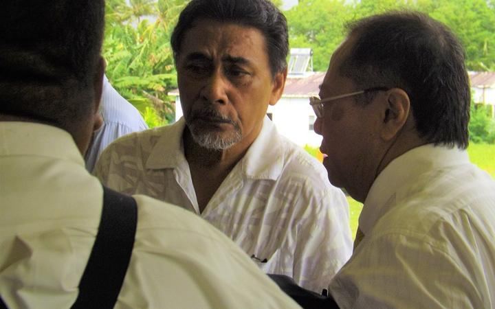 Apulu Lance Polu talking to his lawyer post-verdict
