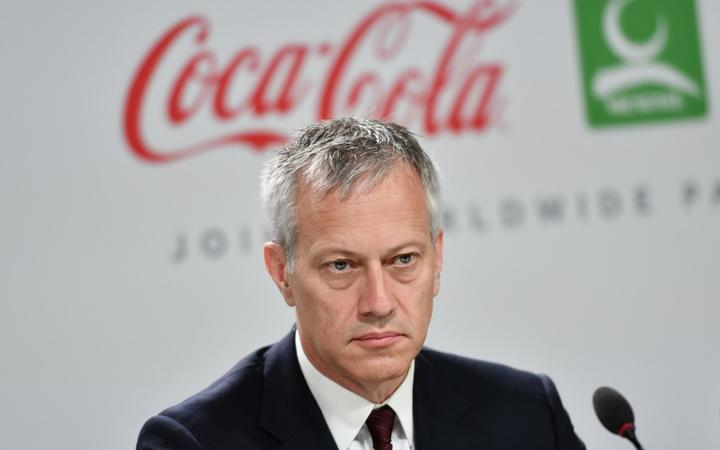 Coca-Cola President and CEO James Quincey attends a press conference with International Olympic Committee (IOC) president and China Mengniu Dairy CEO and Executive Director,