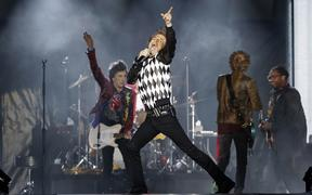 "Ronnie Wood (L), Mick Jagger (C), Charlie Watts (partially hidden) and Keith Richards of the Rolling Stones perform as they resume their ""No Filter Tour"" North American Tour at the Soldier Field on June 21, 2019 in Chicago."