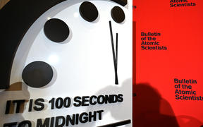 The Doomsday Clock reads 100 seconds to midnight.