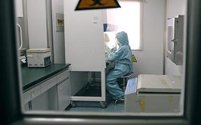 A Chinese medic testing for the swine flu H1N1 virus at a hospital in Hefei, China, in 2009.