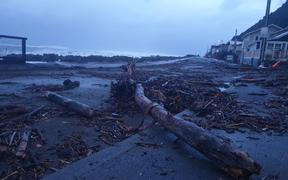 Debris on the shore after southerly gales and large swells at Owhiro Bay, Wellington, 2 July 2020.