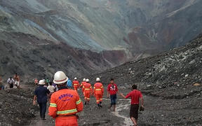 Rescuers attempting to locate survivors after a landslide at a jade mine inthe  Hpakant of Kachin state.