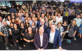 A promotional image from NZME showing editorial staff at the Herald