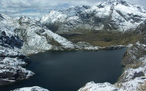 Lake Harris after a snowy day. Taken from the path from Harris saddle to Conical Hill.