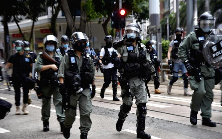 Police officers control the demonstration in Hong Kong Island on July 1, 2020, on the 23rd anniversary of the former British colony's handover to China.