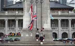 Three British soldiers lower the Union Jack for the last time at the Cenotaph monument in the Central district of Hong Kong on 30 June 1997, just hours prior to the end of some 156 years of British colonial rule as the territory returned to Chinese control.