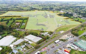 The land in East Drury Kiwi Property is planning to develop with a new town centre and residential development.
