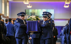 Police colleagues carry the casket of Constable Matthew Hunt at his funeral on 9 July.