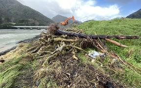 A surging tide ate into land beside the Awatere River mouth, exposing layers of rubbish and dragging them out to sea earlier this week