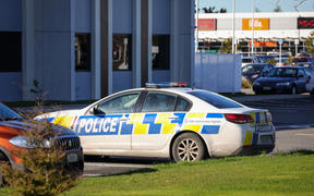 Police vehicle outside the Sudima Hotel, which is being used as a managed isolation facility in Christchurch.