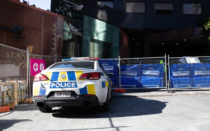 A police car outside Stamford Plaza, which is being used as a managed isolation facility, in Auckland's CBD.
