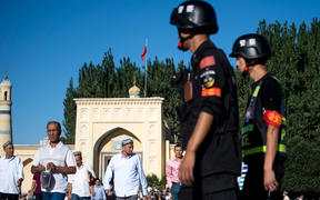 Police patrolling as Muslims leave the Id Kah Mosque after the morning prayer on Eid al-Fitr in the old town of Kashgar in China's Xinjiang Uighur Autonomous Region, on June 26, 2017.