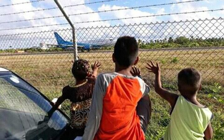 Eritara Kaierua's children wave goodbye to their father as he embarked on his last observer mission.