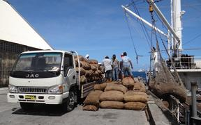 Bags of copra being offloaded for milling at the Tobolar Copra Processing Authority plant in Majuro.