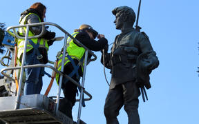 Art restoration team Carolina Izzo, right, and Maria Pagu at work on the cenotaph at Masterton's Queen Elizabeth Park