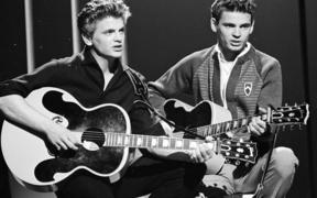 "The Everly Brothers (Phil, left, and Don) perform on ABC's ""American Bandstand"" on July 9, 1960"