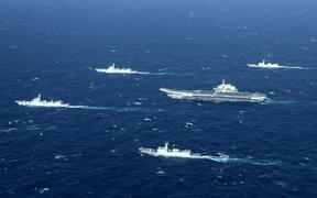 A Chinese Navy formation, including the aircraft carrier Liaoning (C), during military drills in the South China Sea on January 2, 2017.
