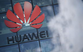 The logo of Chinese company Huawei is seen at their main UK offices in Reading, west of London.