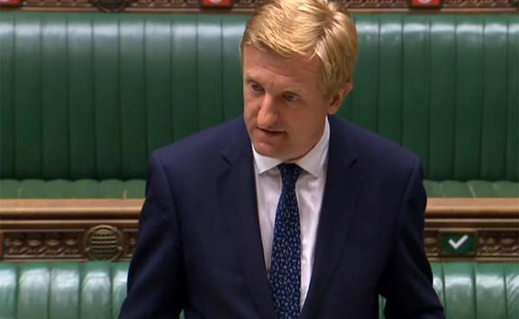 A video grab from footage broadcast by the UK Parliament's Parliamentary Recording Unit (PRU) shows Britain's Culture Secretary Oliver Dowden as he gives a statement to the House of Commons in London on July 14, 2020, on UK telecommunications.