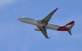 A Qantas Airways plane after taking off from the Sydney Airport in Sydney on March 19, 2020.