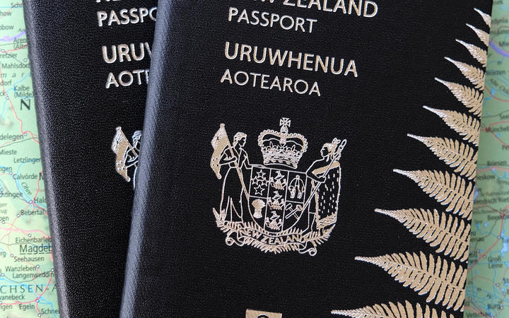 Two New Zealand passports against a map (file photo)