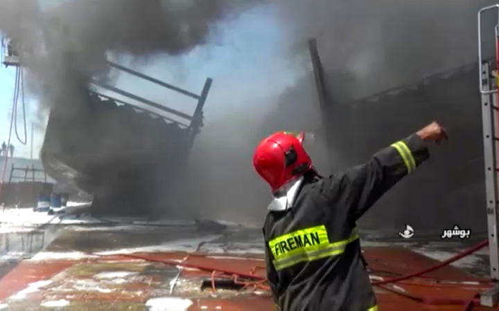 Firefighters combatting a blaze at the Delvar Kashti Bushehr boat factory in the Iranian city of Bushehr.