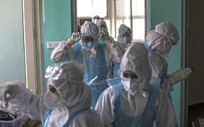 Doctors and nurses wearing Personal Protective Equipment (PPE) suits work at the Intensive Care Unit for Covid-19 coronavirus patients at the Sharda Hospital, India on July 15, 2020.