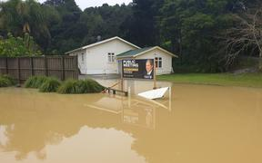 Northland flooding with a New Zealand First billboard.