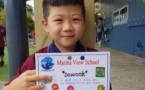 Dowook Kang has been unable to attend his Auckland primary school for almost two months.