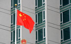The Chinese flag flies outside the consulate on June 4, 2009 in New York.