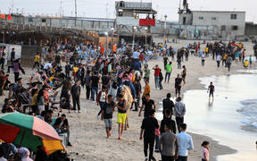 Palestinians gather by the seaside during the Eid al-Fitr in Gaza City on May 26, 2020 amid the coronavirus Covid-19 pandemic.