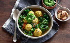 Turmeric and greens soup with chicken, quinoa and sesame dumplings