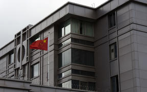 The Chinese flag flies outside the Chinese consulate in Houston after the US State Department ordered China to close the consulate in Houston on 22 July 2020.