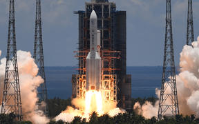 A Long March-5 rocket, carrying an orbiter, lander and rover as part of the Tianwen-1 mission to Mars, lifts off from the Wenchang Space Launch Centre in southern China's Hainan Province on 23 July 2020.