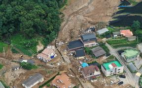 An aerial view shows a damage to a village following a landslide amid heavy rain in the village of Juksan-myeon, near Anseong on August 4, 2020. -
