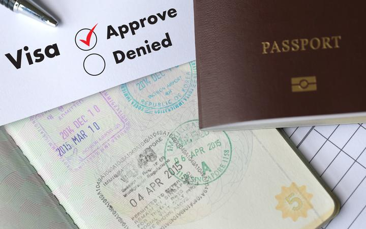 Visa and passport to  approved stamped on a document top view in Immigration