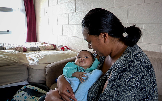 Nicole and her youngest child, who are paying $190 per night in emergency housing at a motel