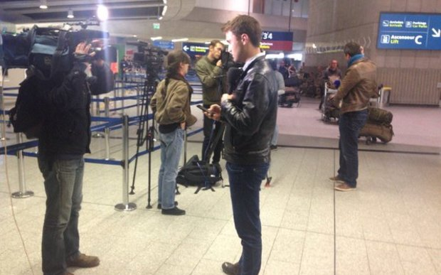 Reporters in front of EgyptAir at Charles de Gaulle airport in Paris.