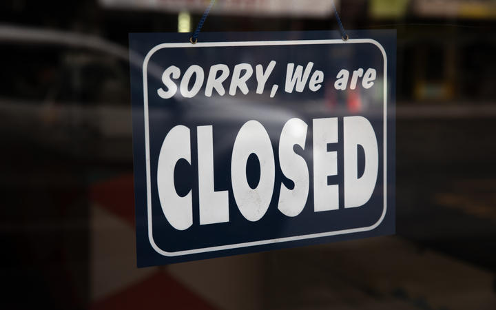 Sign that reads 'Sorry, We are closed' hanging in a shop front in Central Auckland during Lockdown Level 3.