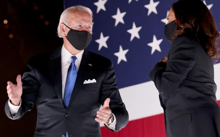 Democratic presidential nominee Joe Biden and Democratic Vice Presidential nominee Kamala Harris confer on stage outside the Chase Center after Biden delivered his acceptance speech  in Wilmington, Delaware.