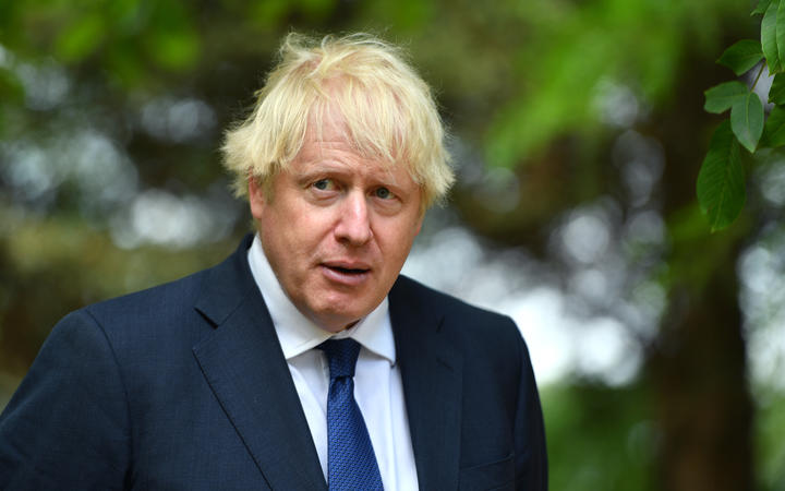 Britain's Prime Minister Boris Johnson attends a national service of remembrance at the National Memorial Arboretum on August 15, 2020.