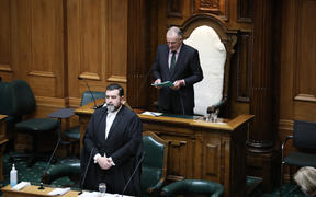 Speaker Trevor Mallard begins Parliament's day with a prayer as Clerk of the House David Wilson listens from The Table