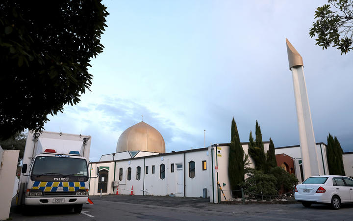 A police vehicle (L) is seen parked by the Al-Noor Mosque ahead of the last day of the sentencing hearing for Brenton Tarrant, the gunman who massacred 51 people during last year's twin mosque attacks, in Christchurch on August 27, 2020.