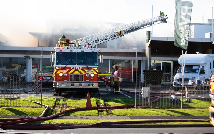 Firefighters battle a blaze that broke out at Maui campervan rental facility in Māngere, South Auckland on the morning of 3 September.
